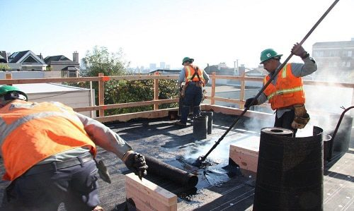Built up roof system being installed by commercial contractor Benton Roofing