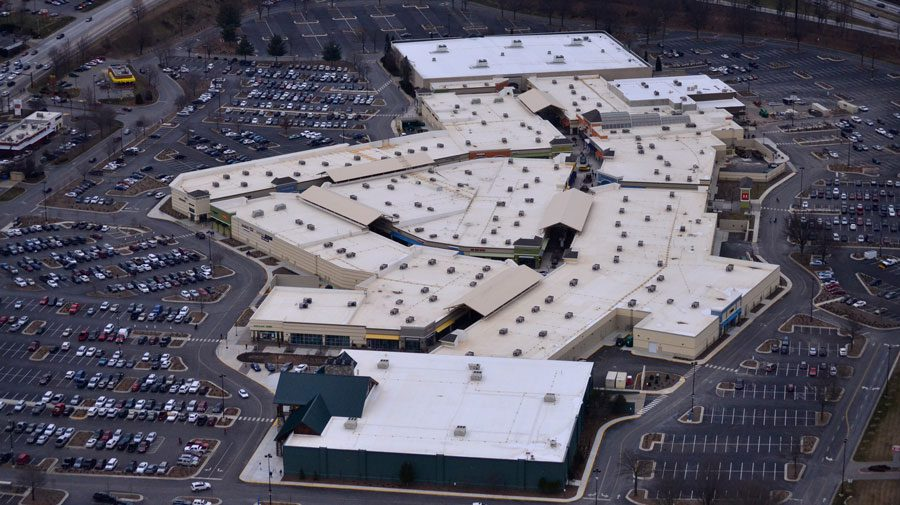 Low slope, single-ply commercial roof installation on the Asheville Outlets in North Carolina