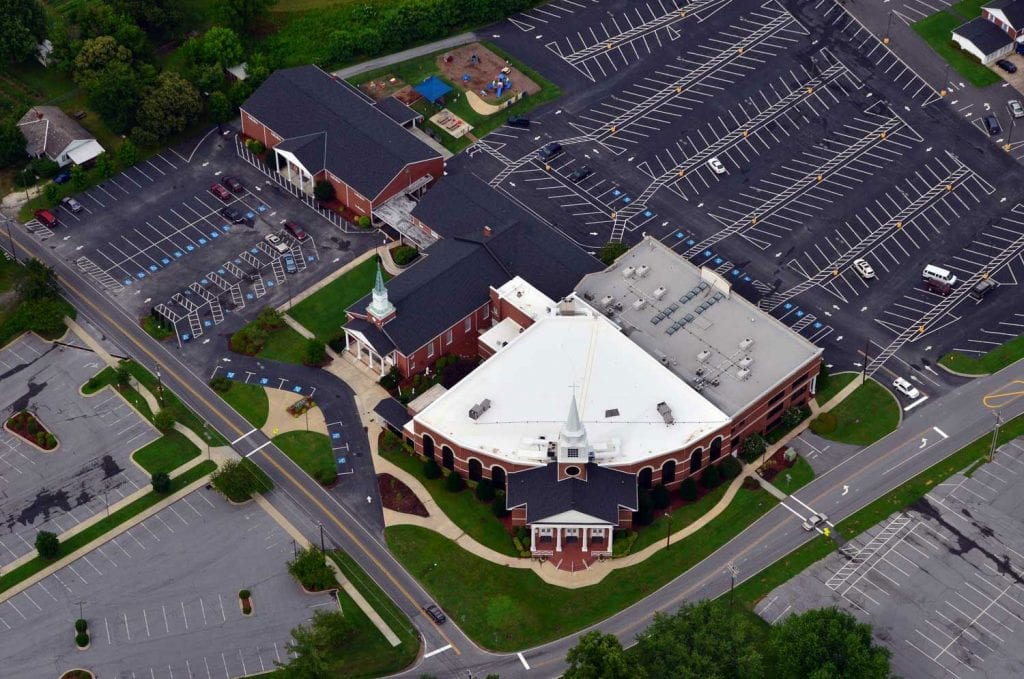 Shingle and low slope roof on church in Hendersonville, NC installed by the southeast's best commercial roofer