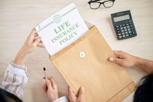 Crop people with contract of life insurance