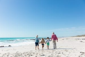 Grandparents and grandchildren at the beach